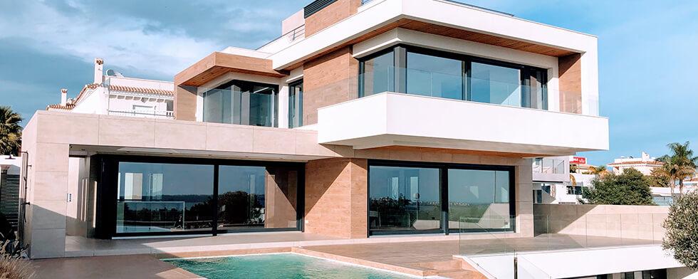 A nice house with big windows and a pool