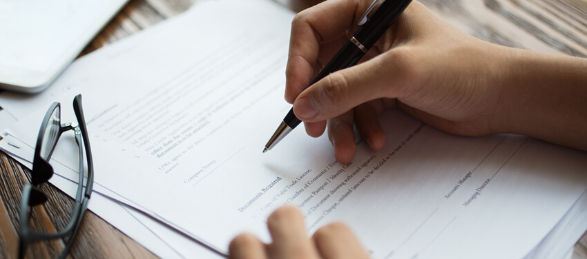 Property buyer signing a contract